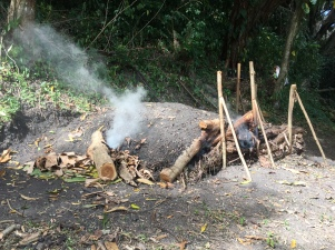 How they make their own charcoal for roasting beans at Crayfish Chocolate.